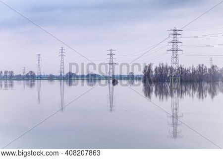 Power Lines And Poles Flooded During High Water In The River Rhinenear Wageningen, Gelderland In The