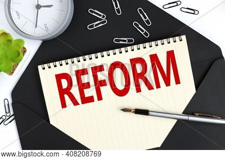 Reform Blackboard - Education Reform Or Other. Hand Writing Reform With Chalk On Black Chalkboard.