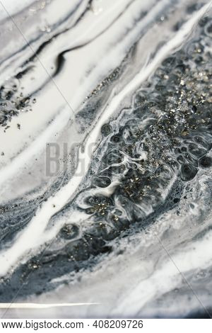 Vertical Background Modern Abstract Design Made With Epoxy Resin. Overflows Of Black, White Resin An