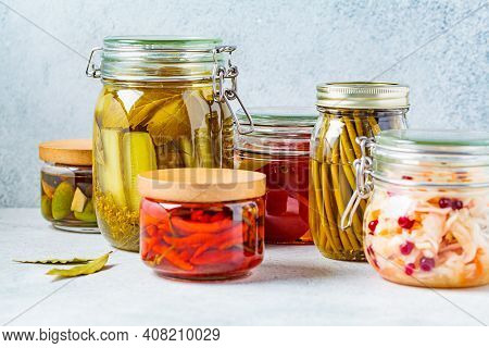 Homemade Pickled Or Fermented Vegetables - Sauerkraut, Wild Garlic, Chili, Pickles, Pickled Tomatoes
