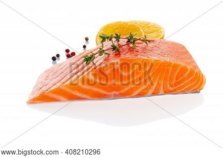 Fresh Raw Uncooked Salmon Fillet Slice Steak Isolated On White Background With Seasoning And Lemon,