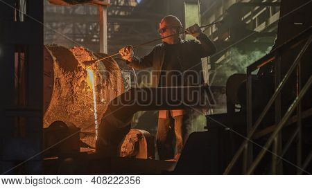 A Steelworker Pours Hot Metal From A Blast Furnace; Lviv, Ukraine, February 10, 2021.