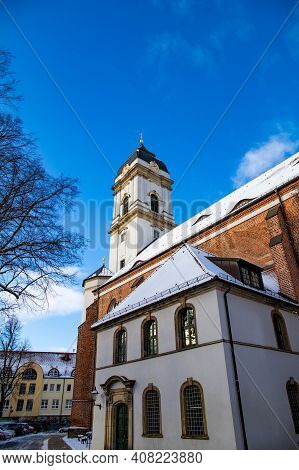 Fuerstenwalde, Brandenburg, Germany - January 30, 2021 Roof and facade of St. Marys Cathedral