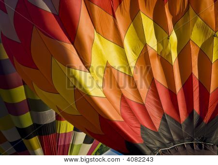 Two hot air balloons up close and personal. poster