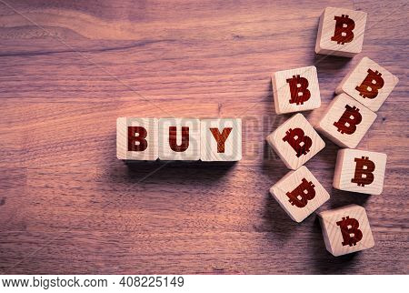 Buy Bitcoin Concept With Wooden Cubes. Wooden Cubes With Text Buy And Cubes With Stylized Symbol Of