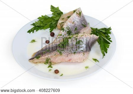 Two Pickled Mild Salted Fillets Of Atlantic Herring Without Skin Sprinkled With Chopped Dill On A Wh