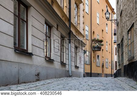 Narrow Deserted City Street. Residential Buildings, Stone Pavement. Windows And Doors, Balcony, Lant