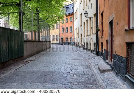 A Modest Deserted Street, Houses, Trees And Bicycles. Stockholm, Sweden.