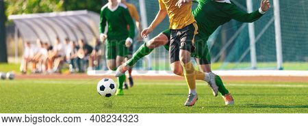 Adult Football Players Compete In Soccer Match. Group Of Footballers Running And Kicking Game. Socce