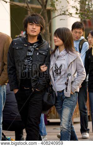 Shanghai, China, Asia - November 29, 2008: Young Chinese Fashion Couple At Nanjing Road In Shanghai.