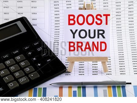 Boost Your Brand On Small Easel With Charts, Pen And Calculator.business