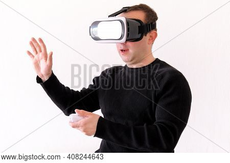 Handsome Man Wearing And Playing Virtual Reality On Isolated White Background. Boy Action In Virtual