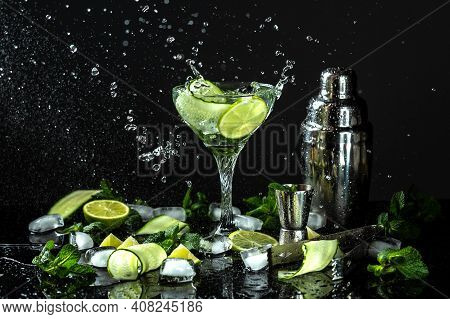 Cucumber Gin And Vodka Alcohol Cocktail. Infused Summer Mocktail With Fresh, Citrus Fruit And Cucumb