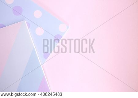 Two Bright Sketchbooks On A Pink Background