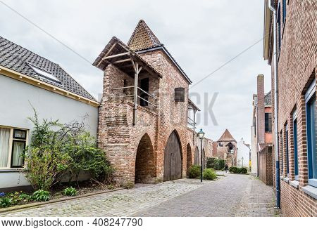Ancient City Wall With A Small House In Zutphen, A Medieval City Along The River Ijssel In Gelderlan