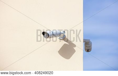 Security Cameras Cctv Isolated On Beige Color Wall Background.