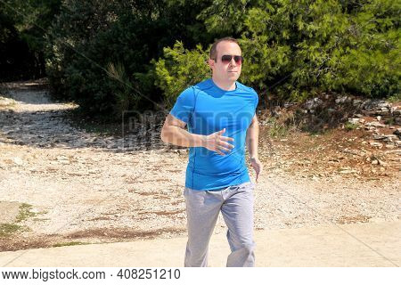 Running Man Athlete Runner Training Outdoor In Forest. Running Runner Sportsmen Wearing Sportswear I