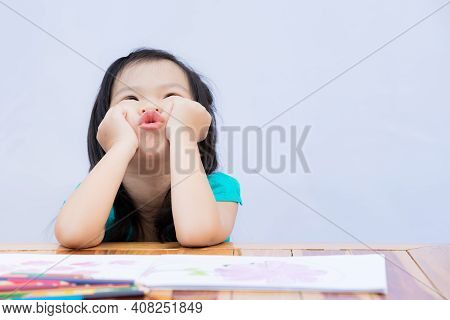 Cute 3-4 Years Old Kid Girl Shows Boredom Of Studying Hard At Home During School Holidays. Child Rai
