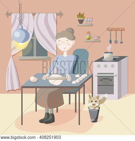 Cozy Evening Of An Elderly Woman With A Cat. The Character Of The Grandmother In The Kitchen Sits At