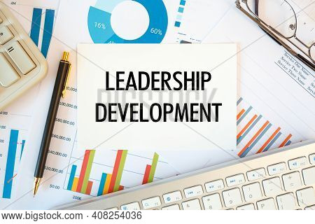 Leadership Development Is Written In A Document On The Office Desk With Office Accessories, Diagram