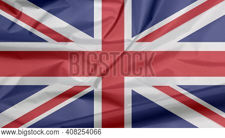 Fabric Flag Of The Union Jack. Crease Of Union Flag Background, It Is The National Flag Of The Unite