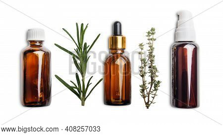 Dropper Bottles With Oil And Herbs Isolated On White Background Flat Lay View. Herbal Cosmetics Conc