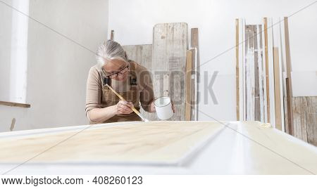 Wood Crafts, Woman Artisan Carpenter Painting With Brush And Paint Jar White The Door In Workshop, W