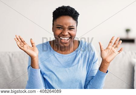 Positive Emotions Concept. Portrait Of Excited African American Woman Smiling, Laughing And Looking