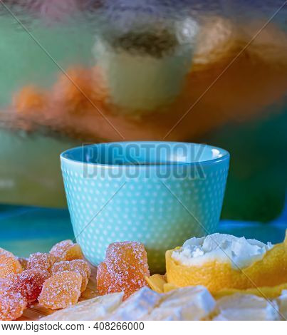 Beautiful Blurred Vertical Background With Reflection. Blue Teacup And Sugar Sweet Ginger And Yellow