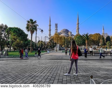 Istanbul, Turkey - October 29, 2019: Tourists In Sultanahmet Square Against The Background Of Blue M