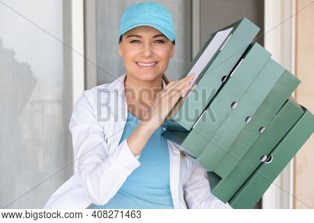Portrait of a Happy Smiling Delivery Girl with Pizza Boxes. Enjoying her Occupation. Delivering Tasty Hot Pizza. Fast Food. Online Order. Summer Job.