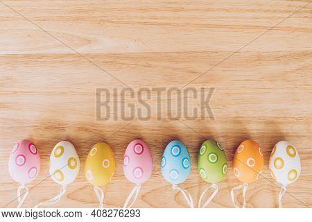 Colorful Easter Eggs On Wooden Table Background Vintage With Copy Space.