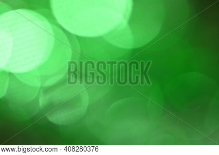 Abstract Green Bokeh Lights For St Patricks Day Celebration Design Background