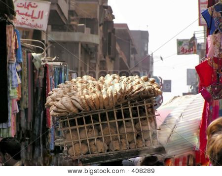 selling bread in egyptian bazaar khan el-khalili, cairo, egypt, africa poster