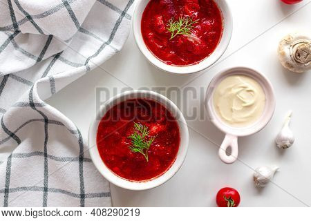 Top View Of The Traditional Ukrainian Borscht Or Soup With Beets, Potatoes, Tomatoes, Meat In Bowls