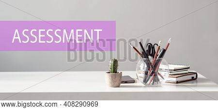 Assessment - Text On The Background Of The Office Table. Business Concept.