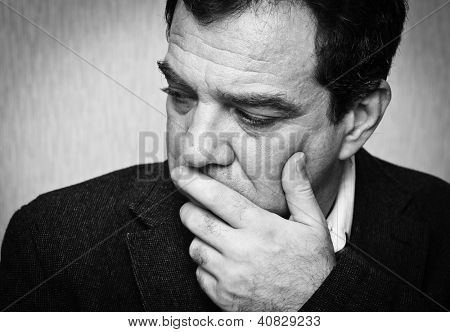 Depression: black and white portrait of a sad man. Series
