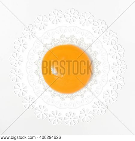 Abstract Yellow Yolk Egg And Vintage Lace Doily