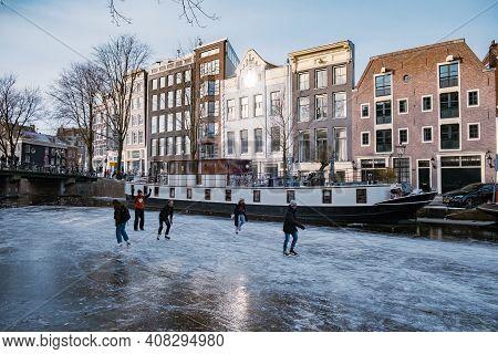 Amsterdam Netherlands February 2021, Ice Skating On The Canals In Amsterdam The Netherlands In Winte