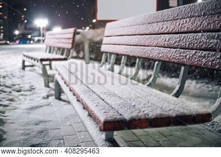 Beautiful Wooden Benches Covered With Snow Close-up In The Park On A Beautiful Winter Evening. Fabul