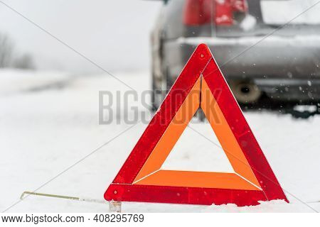 Warning Road Sign Triangle Close-up On The Background Of The Car, Copy The Space. Winter Travel, Roa