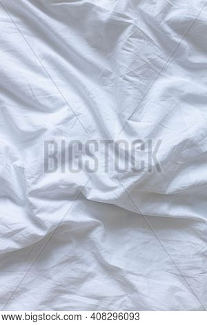 White Bed Linen Background With Copy Space. Vertical Photo
