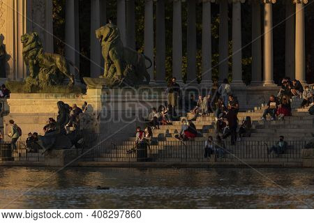 Madrid, Spain - September 29, 2020: People Enjoying Sunset, In The Monument To Alfonso Xii, Located