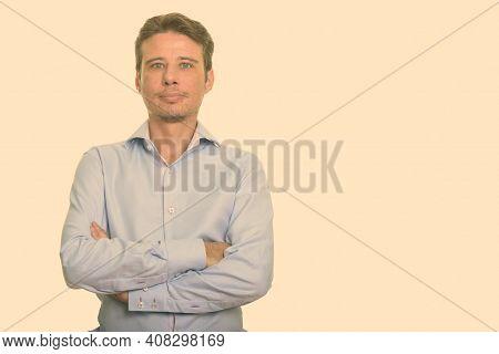 Portrait Of Handsome Caucasian Man Shot Against Plain Studio Background