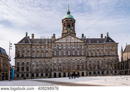 Amsterdam During Winter With Snowy Streets, Amsterdam Dam Square. Amsterdam Netherlands February 202
