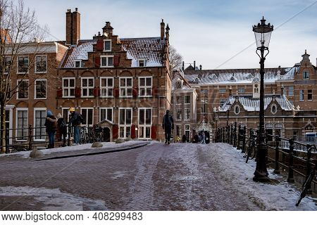 Amsterdam During Winter With Snowy Streets. Amsterdam Netherlands February 2021
