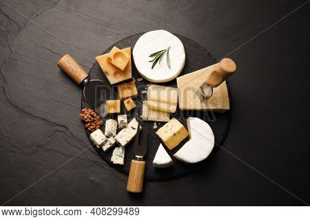 Cheese Platter With Specialized Knives And Fork On Black Table, Flat Lay