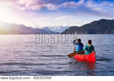 Couple Friends Canoeing On A Wooden Canoe During A Sunny Day. Colorful Sunset Sky Art Render. Taken