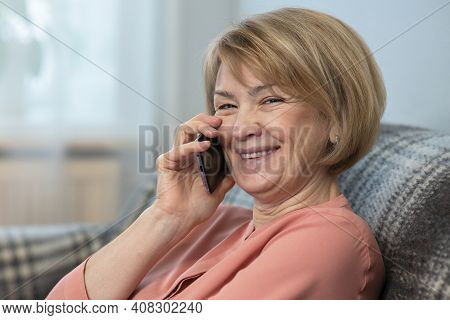 Funny Beautiful Woman, Elderly Senior Adult Mature Lady Is Calling, Talking On Cell Mobile Smartphon