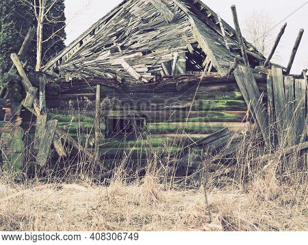 Collapsed Log House. Abandoned Country House. Collapsed Roof